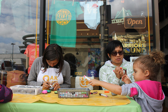 OMCA working with the community outside of the new Oaklandish store in Oakland's Dimond district.