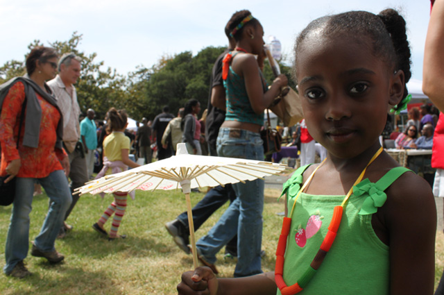 Young girl at Malcolm X Jazz Festival in Oakland. Photo by Sophia Hussain.