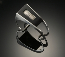 Margaret De Patta, Watch, 1942, sterling silver, ebony, H:  2 in, W: 2.5 in, D: 1 in. Art Deaccession Fund Purchase.