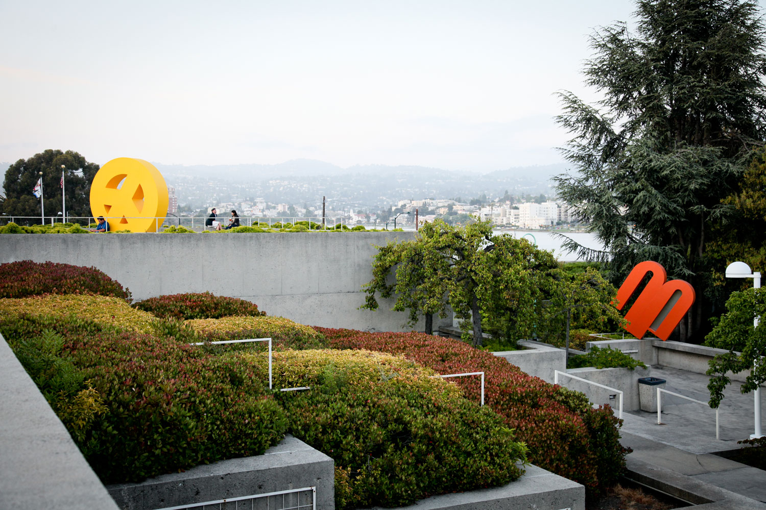 View of Lake Merritt and the famous peace sign sculpture at OMCA