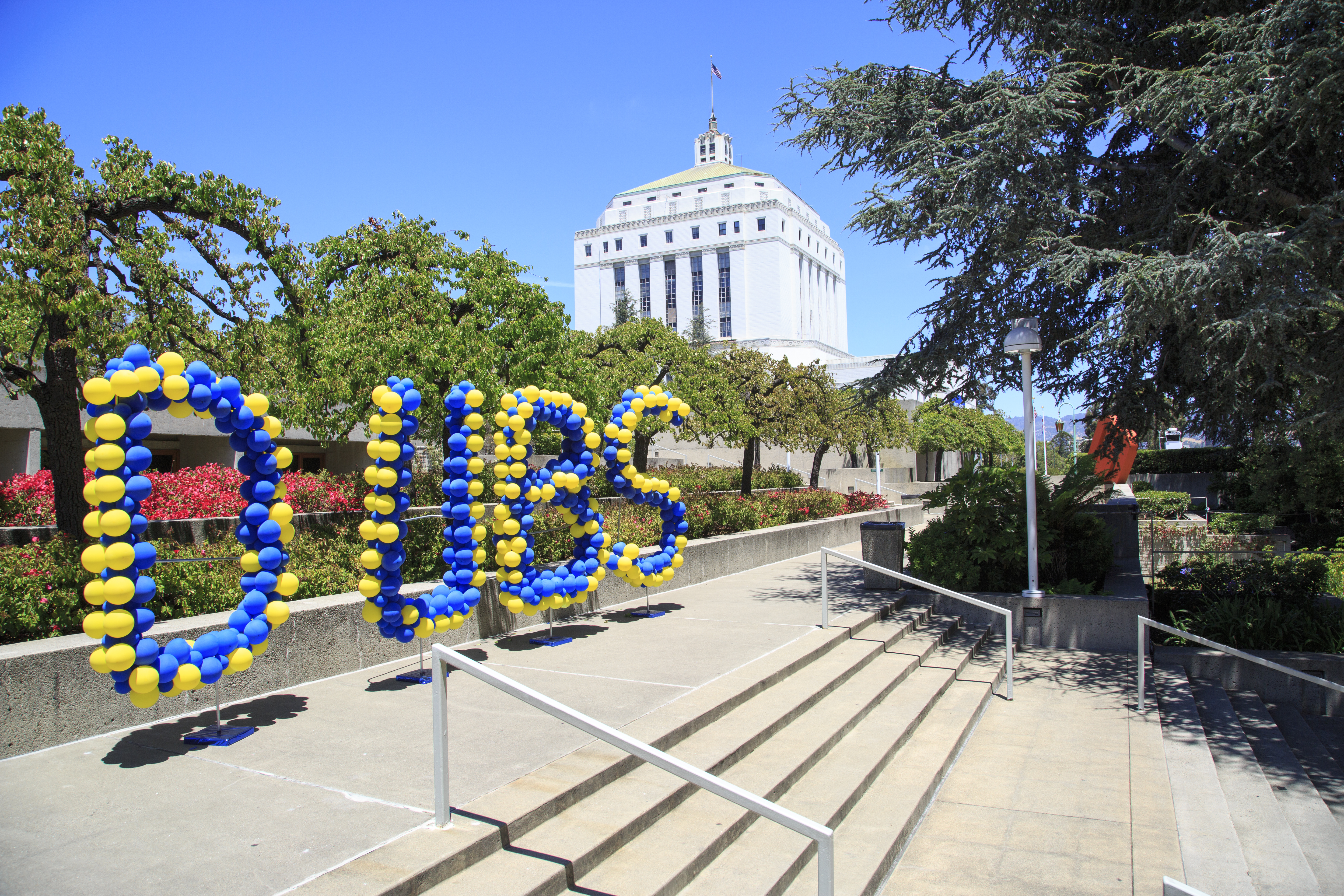 Blue and gold balloons spelling out DUBS at the Oakland Museum of California. Photo: Oakland Museum of California