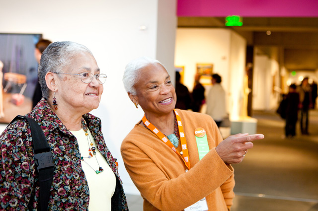 Two women viewing art in the art gallery