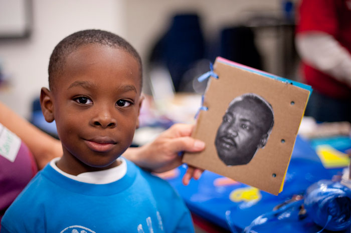 Young boy works on Martin Luther King, Jr. art project at OMCA