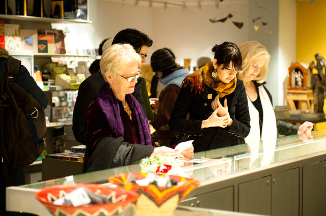 Shoppers browsing jewelry at the OMCA Store at the Oakland Museum of California