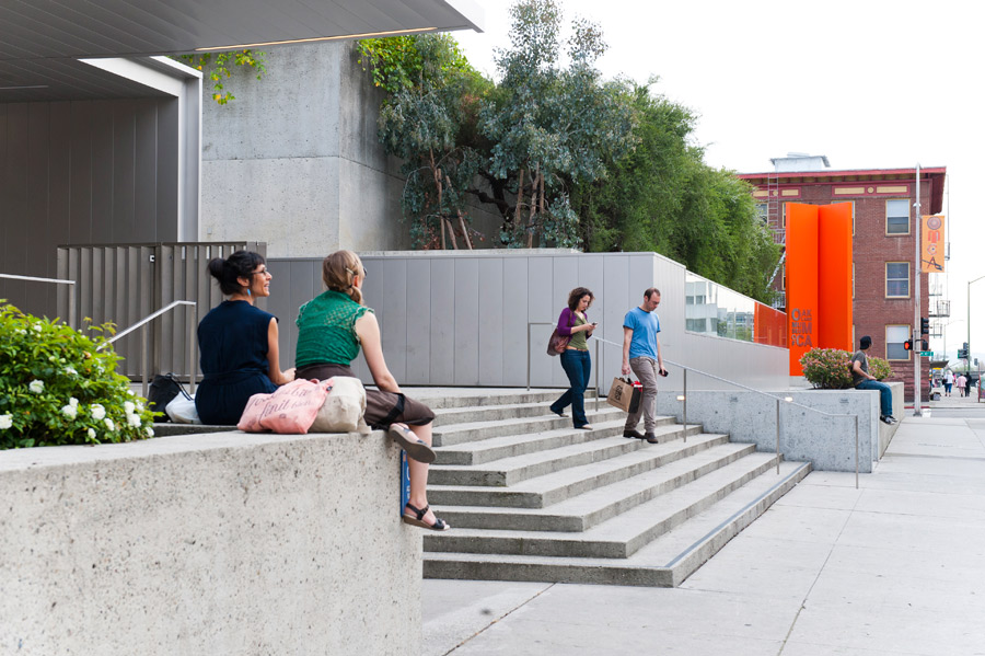 People on the grand steps of the Oak Street Plaza at OMCA in Oakland
