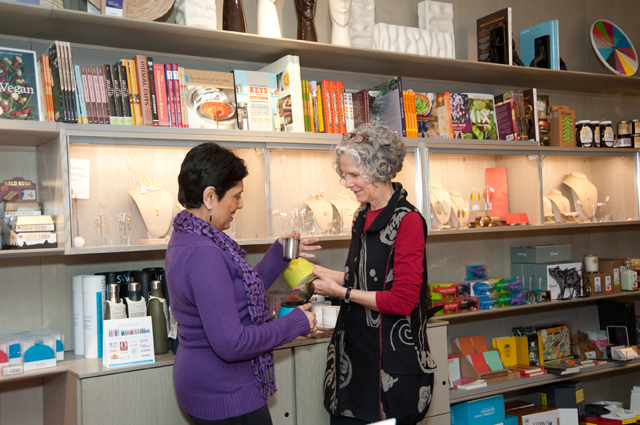 Two women shopping inside the OMCA store