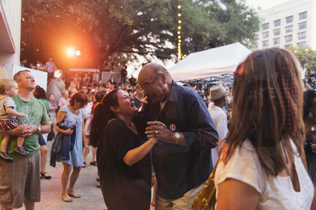 A man and woman dance in the amphitheater during Friday Nights @ OMCA