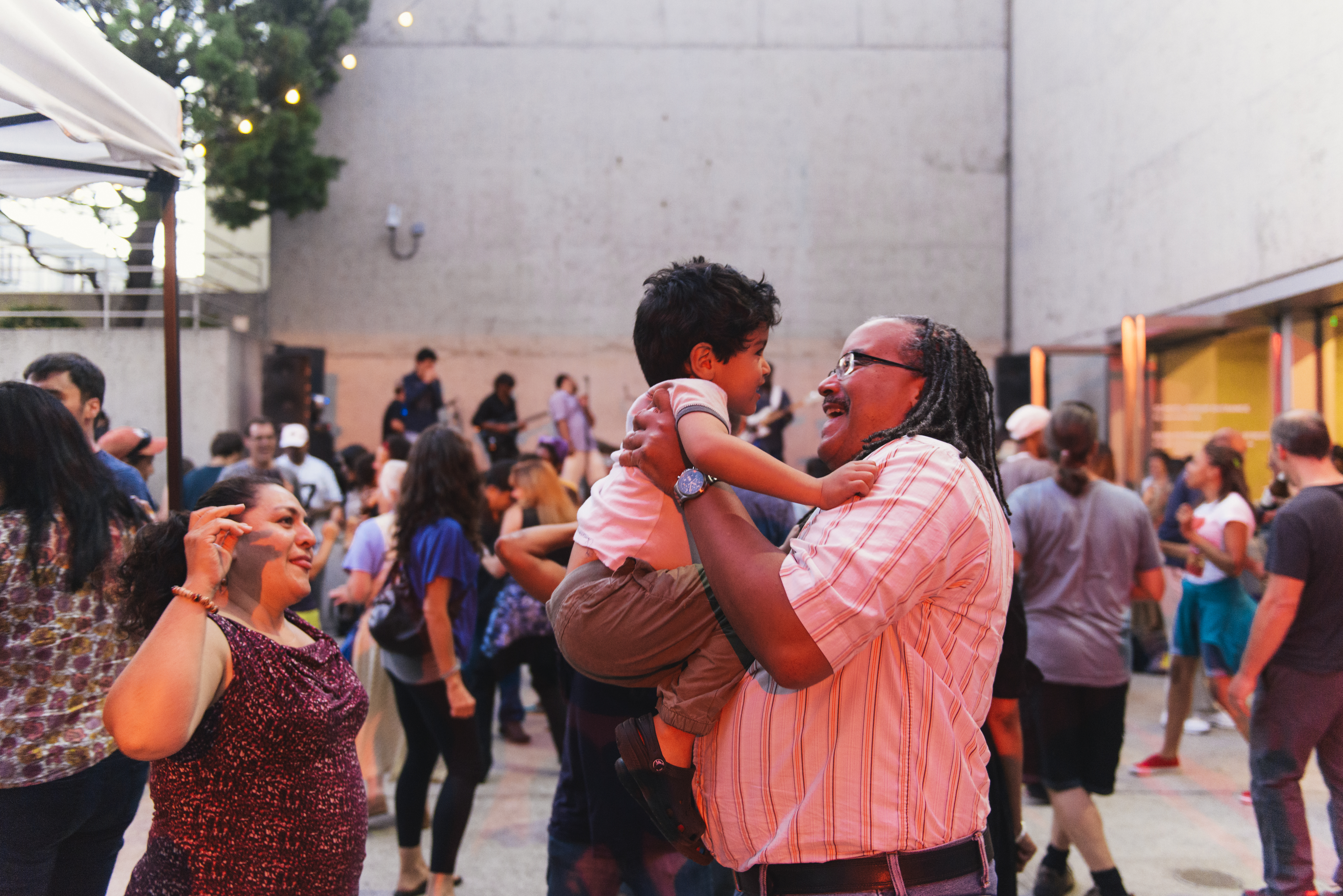 Families dancing at Friday Nights at OMCA