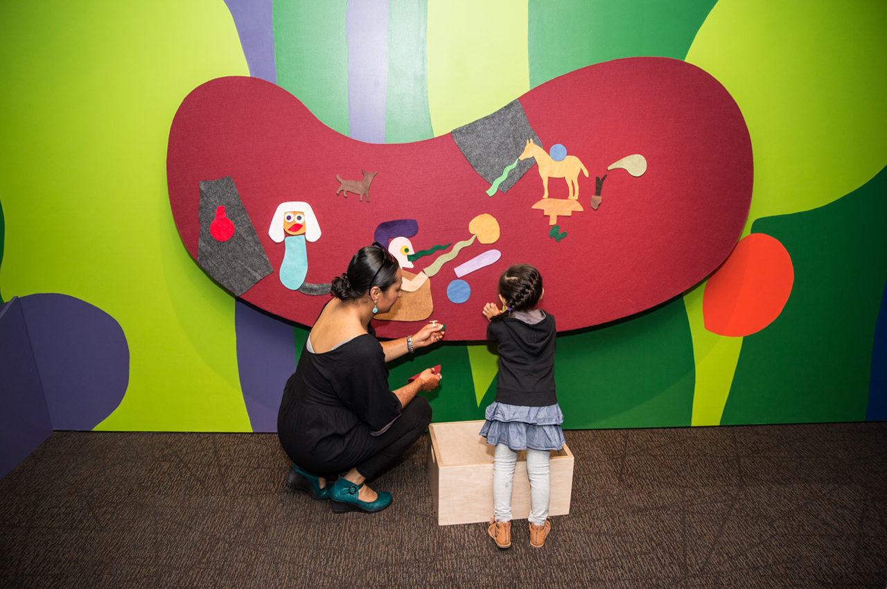Family with kid in Of Dogs and Other People: The Art of Roy De Forest at the Oakland Museum of California