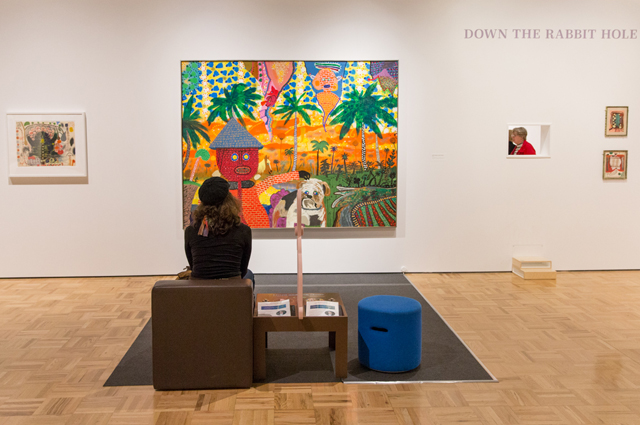 Museum visitor looking at Roy De Forest painting at the Oakland Museum of California