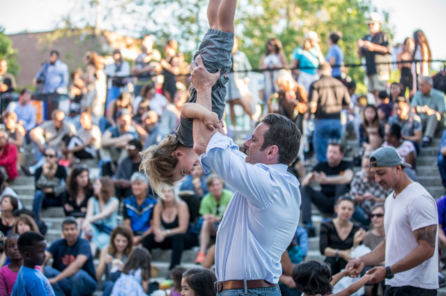 A man dancing with a young girl during Friday Nights at OMCA in Oakland
