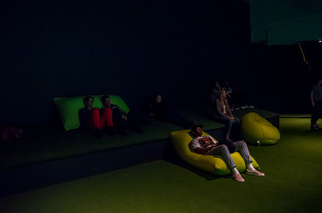 Museum visitors reclining at Nature's Gift: Humans, Friends and the Unknown at the Oakland Museum of California
