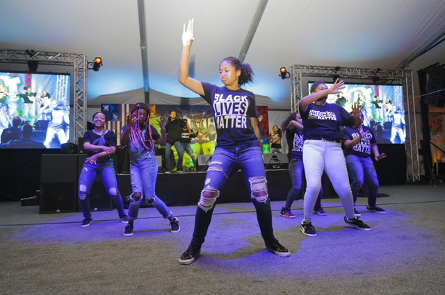 Five girls in Black Lives Matter t-shirts dancing
