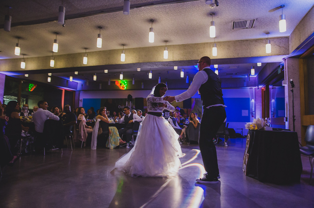 A newly wedded couple dancing in the Blue Oak Cafe