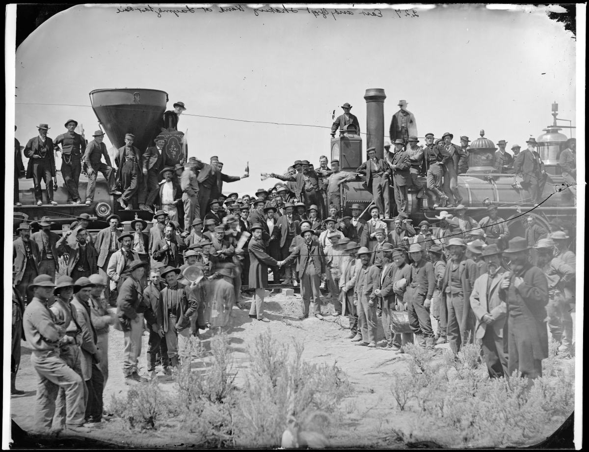 Andrew J. Russell, East and West Shaking Hands at Laying Last Rail, 1869. Imperial collodion glass plate negative, 10 x 13 in. Collection of the Oakland Museum of California, Museum Purchase. Photo: Ben Blackwell.