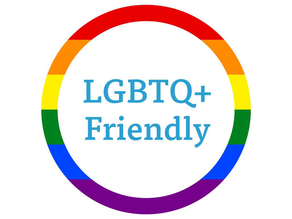 A rainbow circle with text reading LGBTQ+ Friendly
