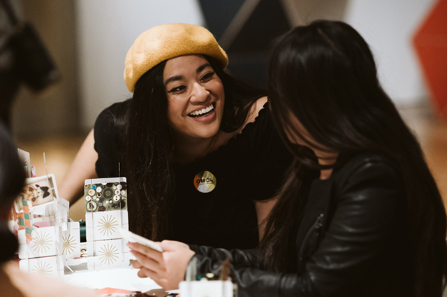 Two women smiling and chatting with each other