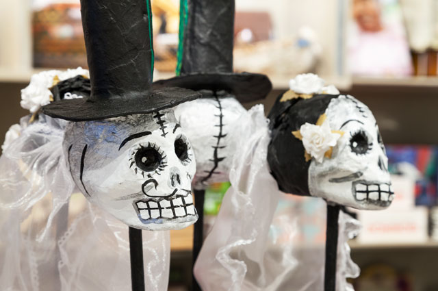 Skeleton sculptures for Days of the Dead at the OMCA Store