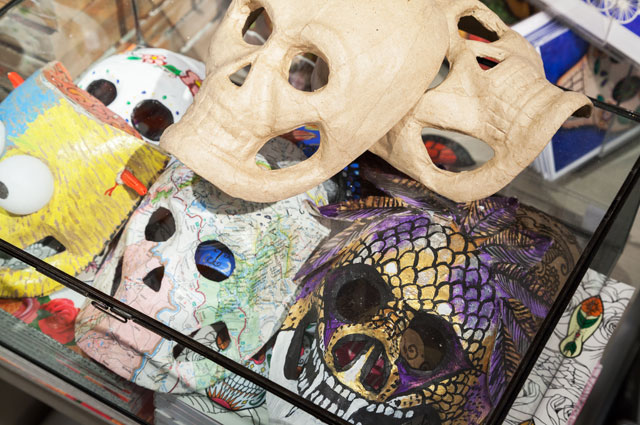 Paper masks of skulls for Days of the Dead at the OMCA Store