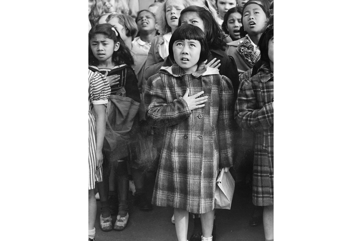 Black and white photo of a group of school children saying the pledge of allegiance