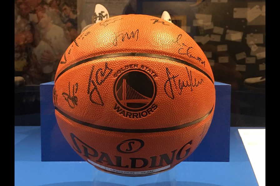A basketball bears the signatures of the entire 2015 Championship team
