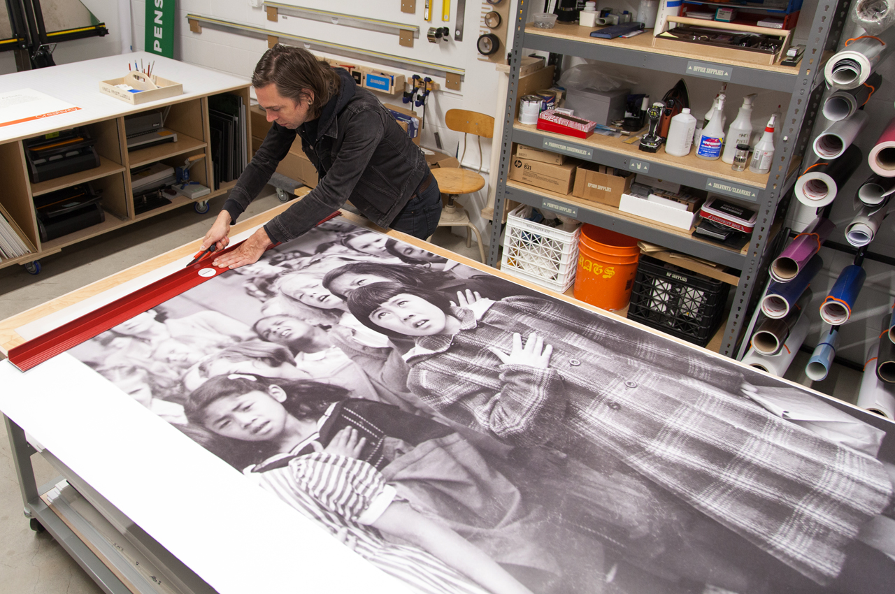 Cropping large-scale reproduction of Dorothea Lange's prints in-house at the Oakland Museum of California