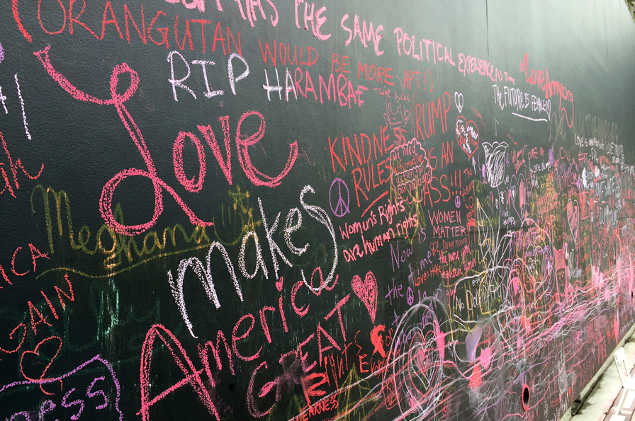 """""""Love makes america great"""" and other notes written on the OMCA chalkboard walk by marchers at the Women's March."""