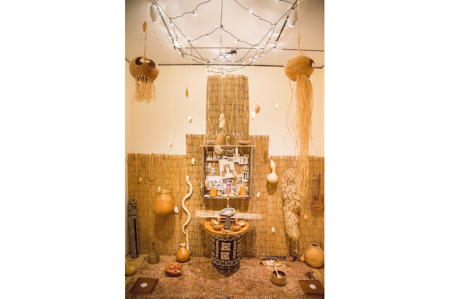 Charles Valoroso, Oración (Prayer), 2015. Kapa cloth, tile, gourd, photographs, wood, shells, mango seeds, ceramic tiles, dimensions variable. Courtesy of the artist. Photo: Odell Hussey Photography