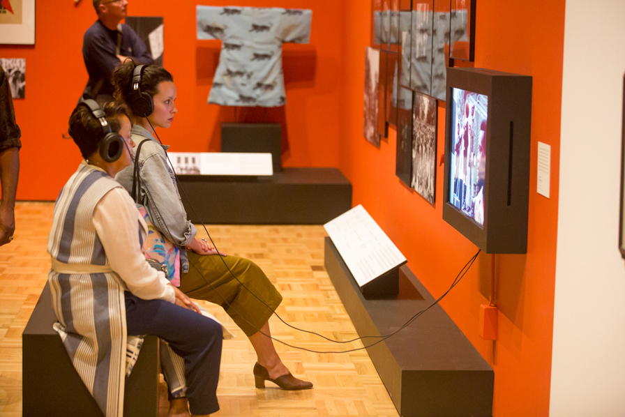 Visitors view an in-gallery media piece in All Power to the People: Black Panthers at 50. Photo: Odell Hussey Photography