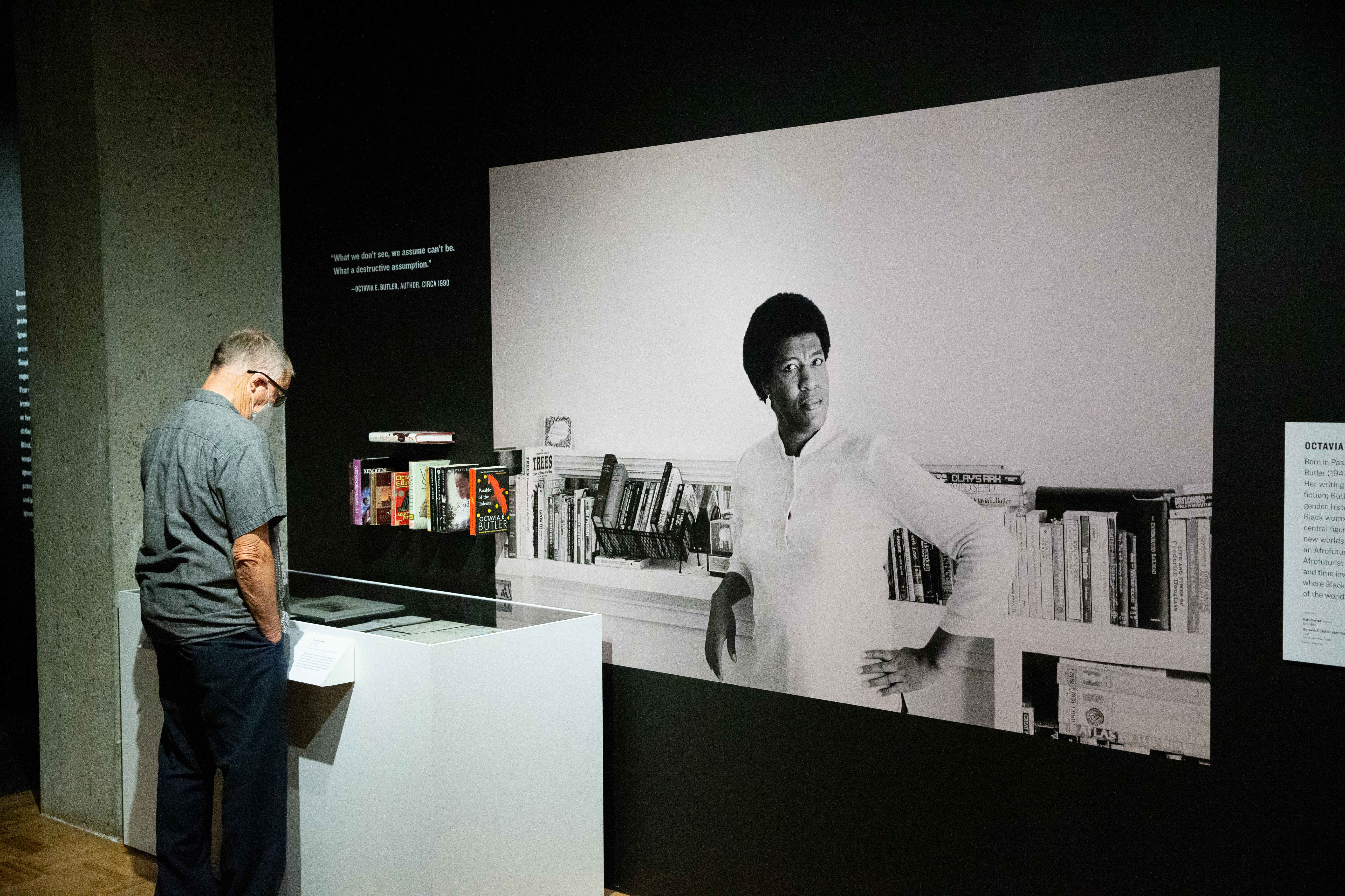 Someone stands at the Octavia Butler section of the Mothership exhibit.