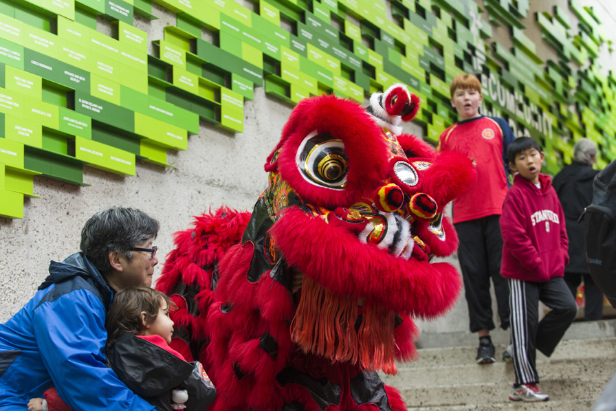 2. Children and families get up close with incredible performers, such as Lion Dancers from the Developing Virtue Secondary School.  Photo: Shaun Roberts. Courtesy of the Oakland Museum of California.