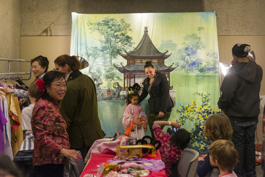 4. Children can have their faces painted and dress up in traditional Chinese Opera style for a fun photo opportunity. Photo: Shaun Roberts. Courtesy of the Oakland Museum of California.