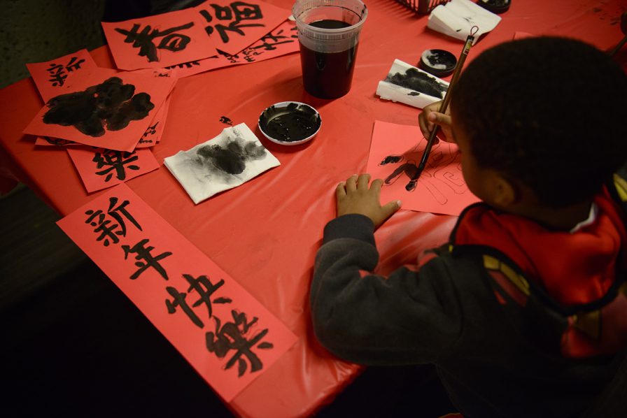 5. Every year, the OMCA Lunar New Year Celebration includes great hands-on activities such as Chinese calligraphy. Photo: Shaun Roberts. Courtesy of the Oakland Museum of California.