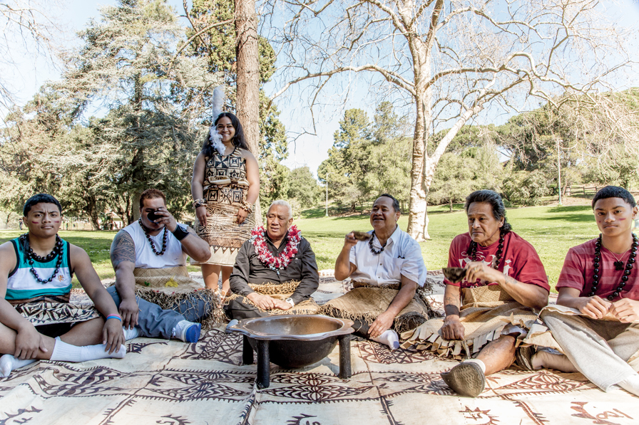 A traditional kava circle gathers in Dimond Park, Oakland. Photo: Jean Melesaine