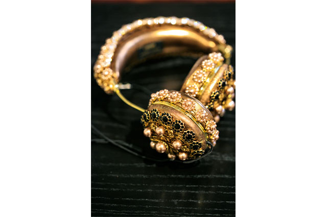 Gold decorated headphones by FRIENDS x Dolce & Gabanna, featured in RESPECT: Hip-Hop Style and Wisdom at the Oakland Museum of California.