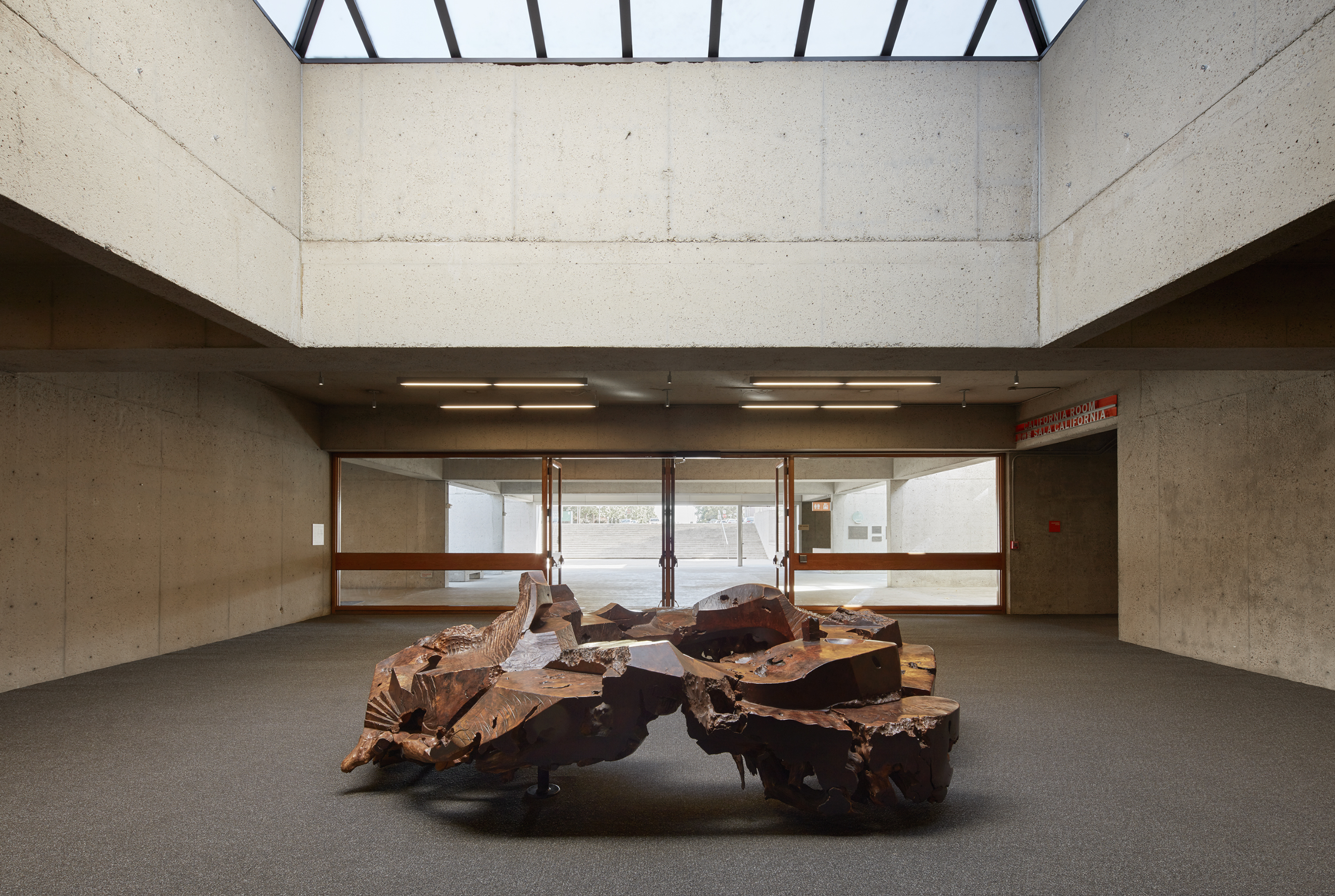A large redwood burl sculpture in the center of OMCA's Natural Sciences lobby