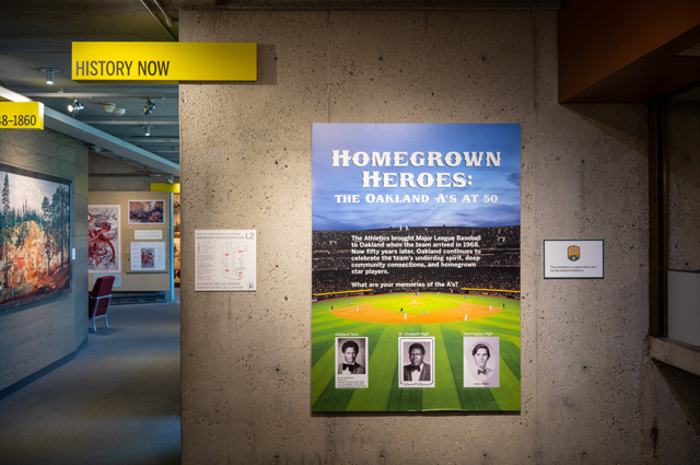 Homegrown Heroes sign hangs on the wall in the History Now section of the History Gallery