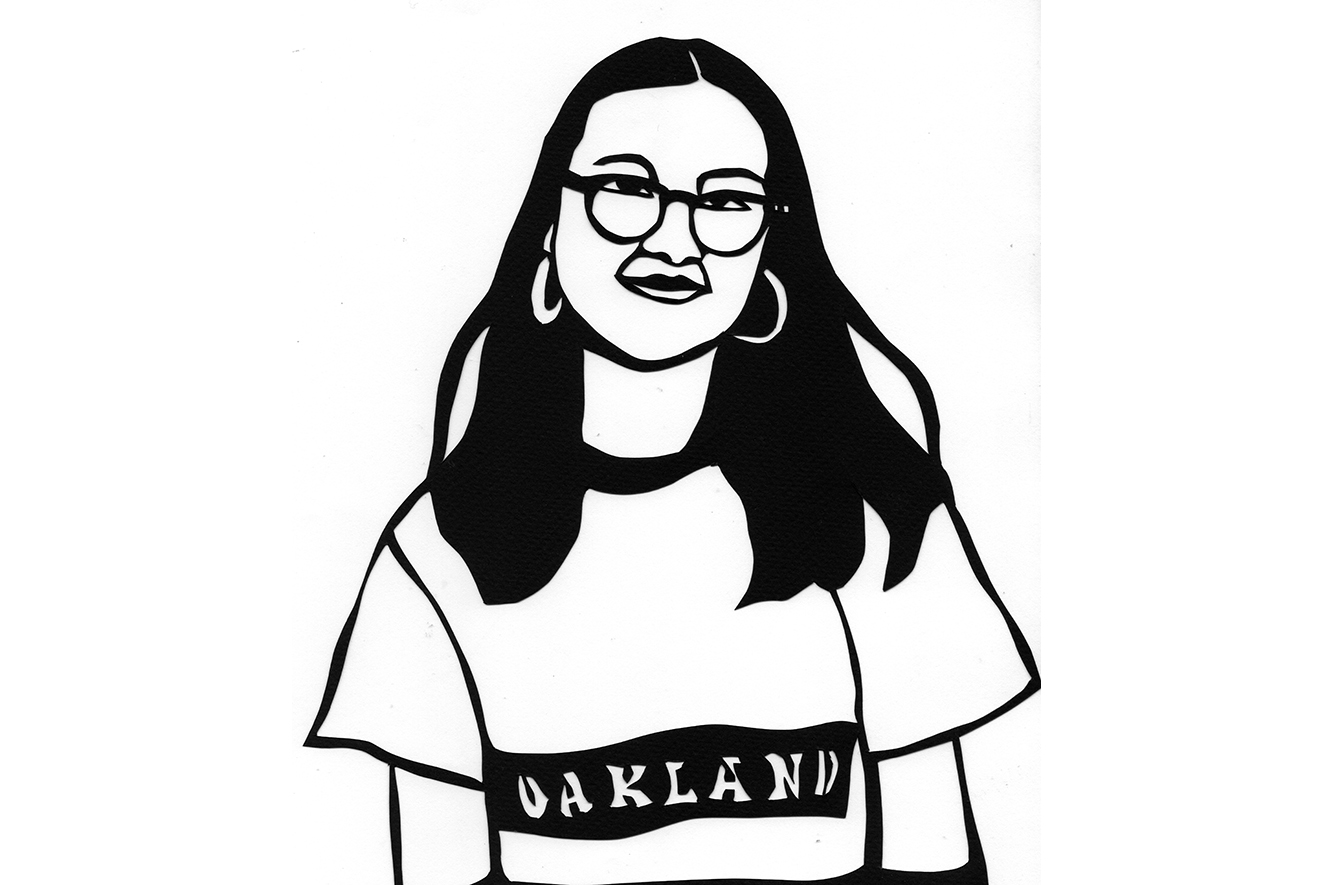 Black and white paper cut out of Kathy Liang wearing a shirt that says Oakland