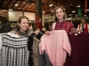 Shoppers holding up finds at the White Elephant Sale