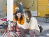 Two women laugh and smile with each other on OMCA's Oak Street Plaza