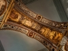 A close up of the intricate patterns on the inside of a golden archway