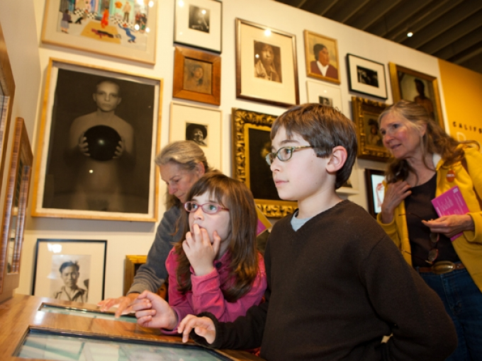 A family plays with an interactive in the Gallery of California Art