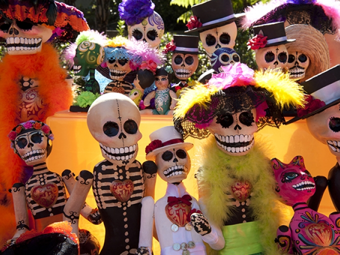 Colorful skeleton sculptures at OMCA's El Día de los Muertos Community Celebration