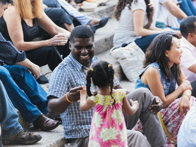 A father and daughter play together on the OMCA amphitheater steps