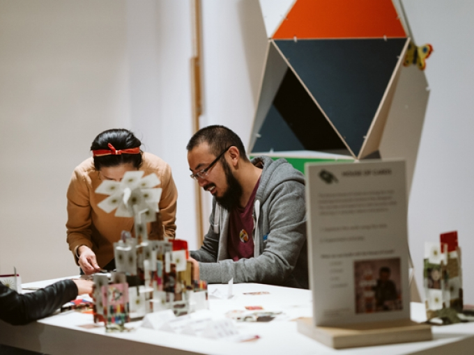People building a house of cards in The World of Charles and Ray Eames