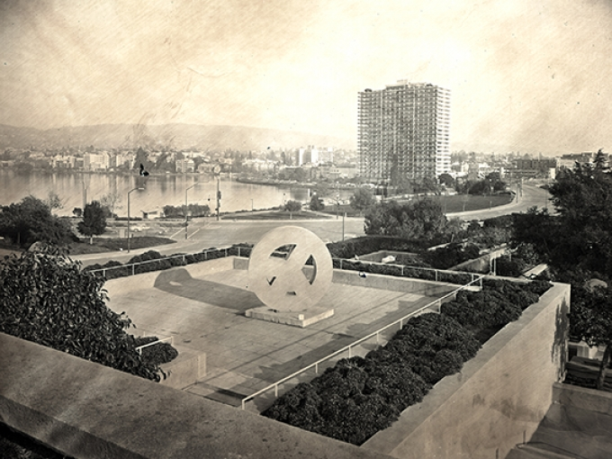 A black and white image of OMCA's peace terrace with Lake Merritt in the background