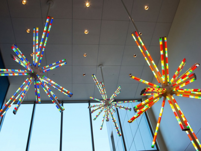Brooklyn-based artist Spencer Finch created three colored lamp sculptures that hang over an entrance of the adult hospital. Photo: Elisabeth Fall, via UCSF