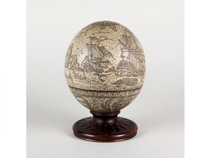 "J.A., Fakeshaw ""ostrich egg"" with whaling scenes, date unknown. Resin and wood, 6.5 x 4.75 (diam.) in. Collection of the Oakland museum of California, Gift of Allen Maret."