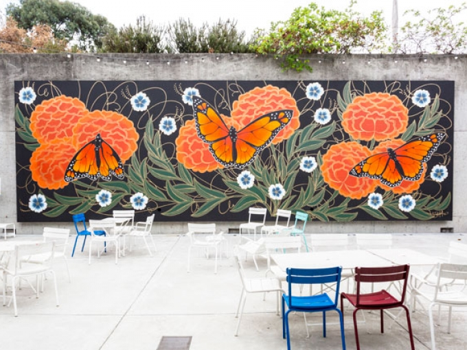 Oakland artist Jet Martinez painted a mural of Monarch Butterflies at the Oakland Museum of California