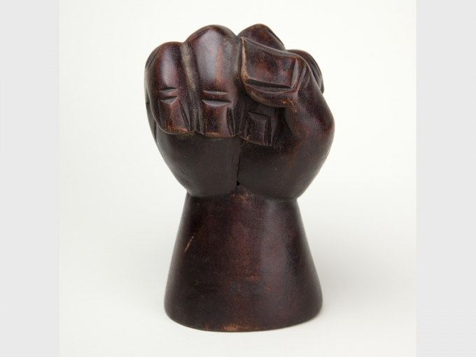 Unknown maker, Untitled (Clenched Fist), circa 1965. Wood, 3(d) x 5.5(h) in. Collection of the Oakland Museum of California, Museum Purchase.